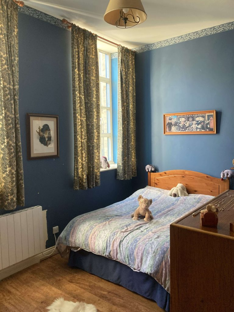 Tall Ceilings Make Great Features: A Converted Mill Bedroom - before image